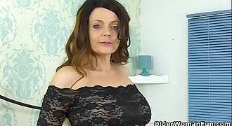 British milf Gemma Gold pleases her hungry cunt with a faux-cock